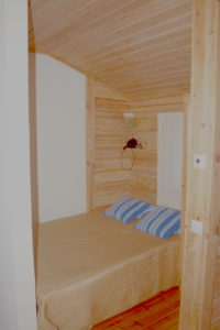 Double bed in the lakeside sauna building