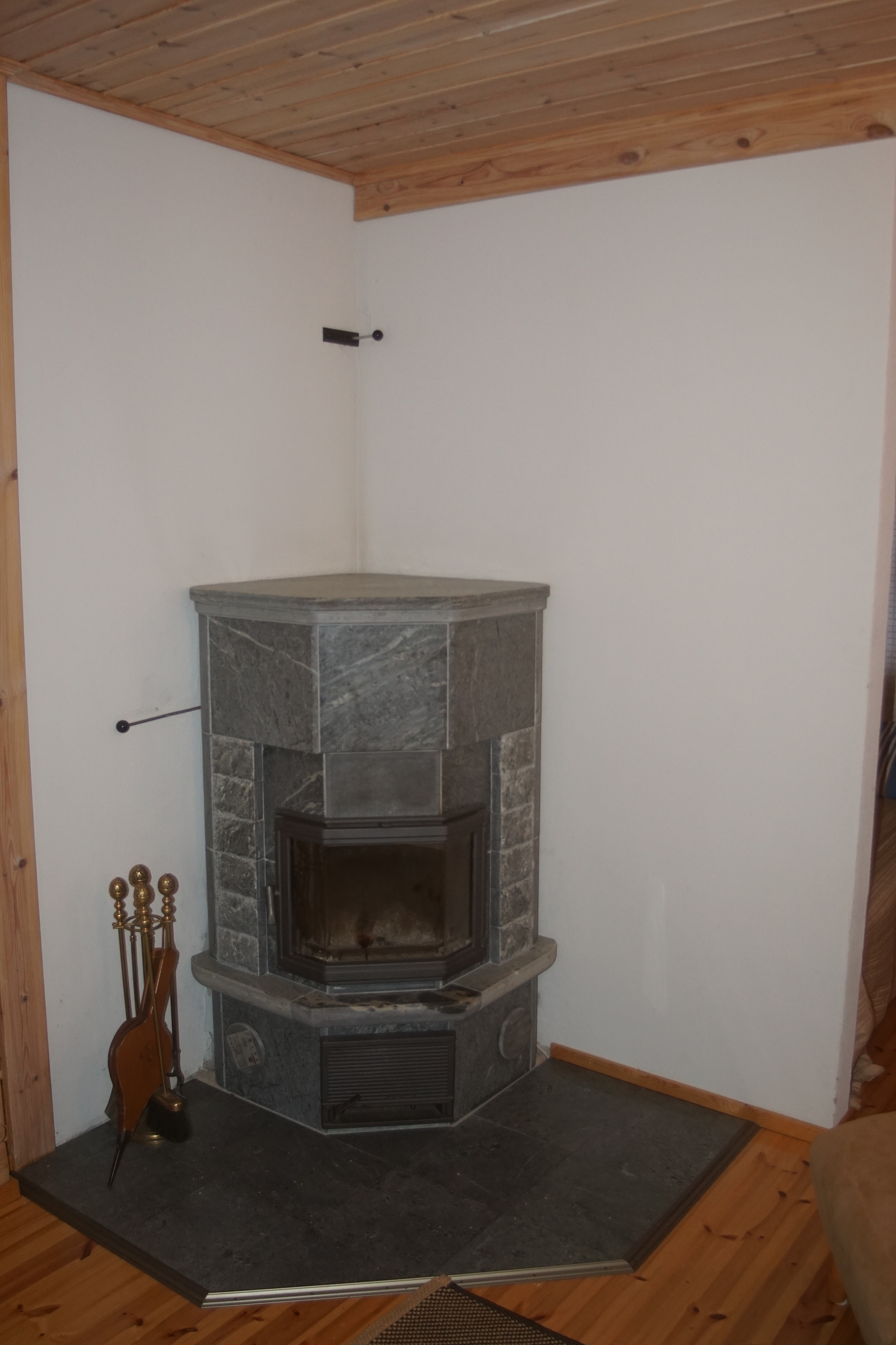 Fireplace in the lakeside sauna building